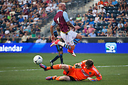 Zac MacMath of the Philadelphia Union blocks Stephen Ireland of Aston Villa's shot during a match between Aston Villa FC and Philadelphia Union at PPL Park in Chester, Pennsylvania, USA on Wednesday July 18, 2012. (photo - Mat Boyle)
