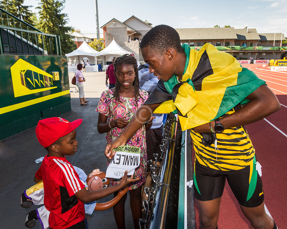 Manley, Jamaica, signs autograph for young fan
