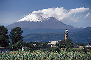 Snowcapped, smoking, Popocatepetl Volcano, near Puebla, Mexico.