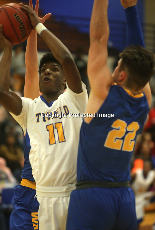 Tupelo's Fabion Perry looks for his shot against Oxford defender Drew Bianco in the second quarter Friday night.