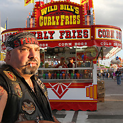 After retiring from the USMC, Danny Lajos from Colorado, tours working different state fairs. Food and rides are the main attraction around the midway of the South Florida State Fair.<br /> Photography by Jose More