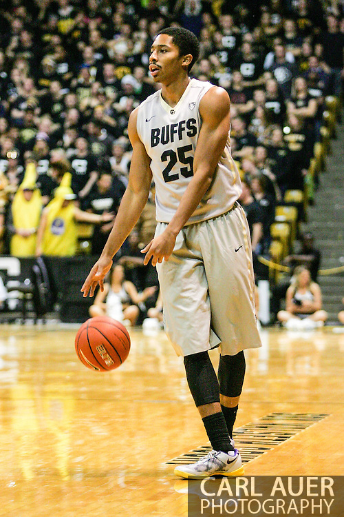 December 7th, 2013:  Colorado Buffaloes junior guard Spencer Dinwiddie (25) brings the ball up the court in the second half of the NCAA Basketball game between the Kansas Jayhawks and the University of Colorado Buffaloes at the Coors Events Center in Boulder, Colorado