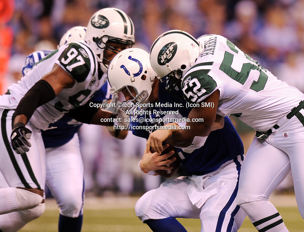 January 24, 2010: New York Jets at Indianapolis Colts AFC Championship game at Lucas Oil Stadium in Indianapolis, IN: Indianapolis Colts quarterback Payton Manning (L) is sacked by New York Jets David Harris (R) and teammate Calvin Pace in the first quarter of the AFC Championship game. PHOTO BY:Anthony J. Causi