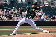 MESA, AZ - MARCH 09:  Sean Manaea #55 of the Oakland Athletics delivers a pitch in the first inning of the spring training game against the Cincinnati Reds at HoHoKam Stadium on March 9, 2017 in Mesa, Arizona.  (Photo by Jennifer Stewart/Getty Images)