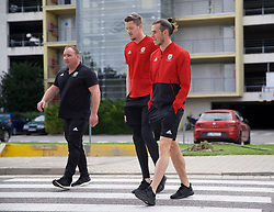 BRATISLAVA, SLOVAKIA - Thursday, October 10, 2019: Wales' goalkeeper Wayne Hennessey (L) and Gareth Bale during a pre-match team walk near the Hotel NH Bratislava Gate One ahead of the UEFA Euro 2020 Qualifying Group E match between Slovakia and Wales. (Pic by David Rawcliffe/Propaganda)