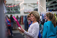 """20151206, Sunday, December 6, 2015, North Easton, MA, USA; The Christmas program at My Brother's Keeper in Easton is planning to serve well over 2,700 families and over 11,000 parents and children for 2015.<br />  <br /> The regional Christian Ministry, based in North Easton Massachusetts, was moving at full steam during the second day of the annual volunteer-fueled Christmas program with a warehouse full of volunteers wrapping and selecting gifts on stocked shelves waiting to packaged for children and families for a special Christmas morning.<br /> <br /> The charity gift giving and wrapping program, in it's 25th year, is ongoing in """"Santa's Workshop"""" during the Advent season 11 a.m. to 8 p.m. each day.<br /> <br /> ( lightchaser photography © 2015 )"""
