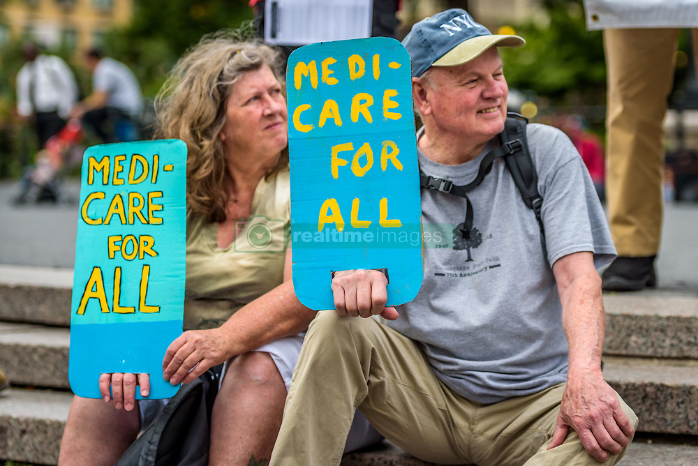July 24, 2017 - New York, New York, United States - Hundreds of New Yorkers joined a grassroots alliance of health care advocates in a rally on the steps of Union Square to demand a universal, single payer, improved and expanded Medicare healthcare system and an end to for-profit healthcare. Coordinating rallies have been organized in communities across the country, with the founding rally being held in Washington D.C. (Credit Image: © Erik Mcgregor/Pacific Press via ZUMA Wire)