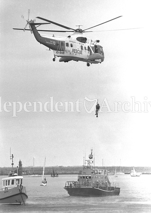 Irish Coast Guard Sikorsky S-92 Helicopter on-station during the Dept of Marine Emergency Rescue Service demonstration in Dun Laoghaire, 23/06/1996 (Part of the Independent Newspapers Ireland/NLI Collection).
