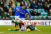 Alfredo Morelos (#20) of Rangers evades the sliding challenge of Ryan Porteous (#36) of Hibernian during the Ladbrokes Scottish Premiership match between Hibernian and Rangers at Easter Road, Edinburgh, Scotland on 19 December 2018.