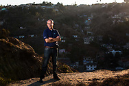 Oscar Romo stands in front of Tijuana's Los Laureles Canyon, where he founded his nonprofit, Alter Terra, in 2008. The paved-over creek at the bottom of Los Laureles flows directly north to the border with the United States and the canyon is a major source of pollution due to informal development and a lack of basic infrastructure.