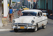 PINAR DEL RIO, CUBA -  OCTOBER 24, 2006: Unidentified person drives vintage American car at the street of Pinar del Rio in Pinar del Rio, Cuba.