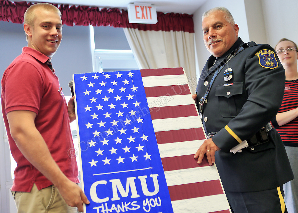 "Colin Powell said, ""You can be sure that the American spirit will prevail over this tragedy."" Twelve years later, it certainly has. CMU students remembered 9/11in many ways Wednesday including a local emergency responders recognition ceremony in the University Center. Flags also decorated campus outside both the University Center and the Park Library.  Photos by Steve Jessmore/Central Michigan University"