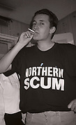 Paul Heaton smoking in a Northern Scum t-shirt, Manchester, UK, circa 1989, .