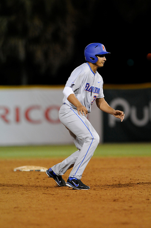 March 2, 2012: Vickash Ramjit #30 of Florida in action during the game between the Miami Hurricanes and Florida Gators at Alex Rodriguez Park in Coral Gables, FL. The Gators defeated the Hurricanes 7-5.
