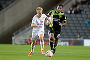 Milton Keynes Dons midfielder Ben Reeves (10) looks to release the ball during the EFL Sky Bet League 1 match between Milton Keynes Dons and Bury at stadium:mk, Milton Keynes, England on 27 September 2016. Photo by Dennis Goodwin.