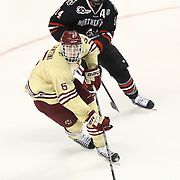 Steven Santini #6 of the Boston College Eagles keeps the puck from Braden Pimm #14 of the Northeastern Huskies during The Beanpot Championship Game at TD Garden on February 10, 2014 in Boston, Massachusetts. (Photo by Elan Kawesch)