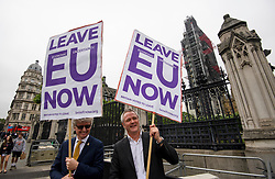 © Licensed to London News Pictures. 12/06/2018. London, UK. Pro Brexit campaigners stand outside the Houses of Parliament in London. Photo credit: Ben Cawthra/LNP