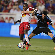 David Villa, (right), NYCFC, challenges Chris Duvall, New York Red Bulls, during the New York Red Bulls Vs NYCFC, MLS regular season match at Red Bull Arena, Harrison, New Jersey. USA. 10th May 2015. Photo Tim Clayton