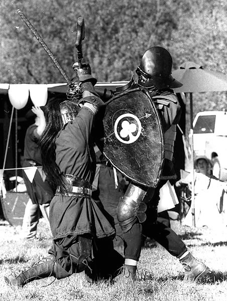 Marcus of Silver Oak (right) participates in heavy weapons fighting, a sport and martial art in the SCA.
