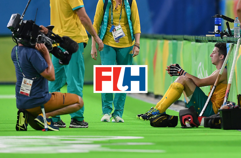 Australia's Simon Orchard sits on the field at the end of the men's quarterfinal field hockey Netherlands vs Australia match of the Rio 2016 Olympics Games at the Olympic Hockey Centre in Rio de Janeiro on August 14, 2016. / AFP / MANAN VATSYAYANA        (Photo credit should read MANAN VATSYAYANA/AFP/Getty Images)