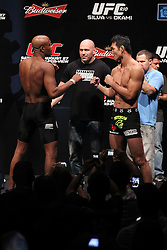 August 26, 2011; Rio De Janiero, Brazil; UFC Middleweight Champion Anderson Silva (left) and Yushin Okami (right) pose after weighing in for their upcoming bout at UFC 134.