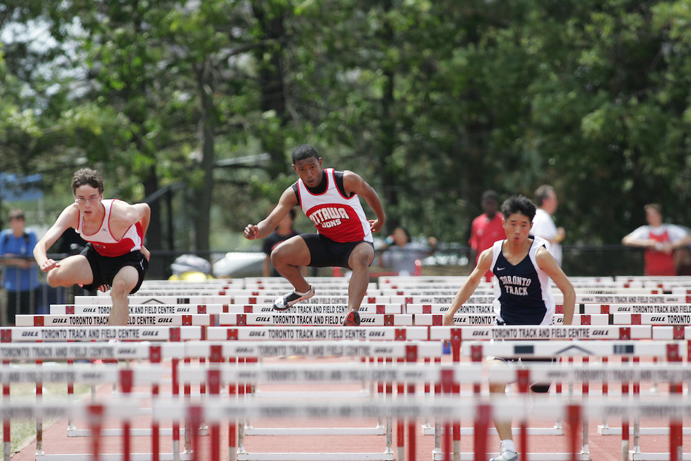 Adrian Huynh in the juvenile boys 110m hurdles at the 2007 OTFA Supermeet II. The Ontario Track and Field Association Bantam-Midget-Juvenile Championships were held in Toronto from August 3rd to 5th.
