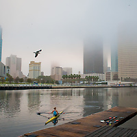 TAMPA, FL  -- Fog lifts over the water near the Tampa Bay Rowing Club on the University of Tampa campus near the Cass Street Bridge in Tampa, Florida. (Chip Litherland for Bay Magazine)