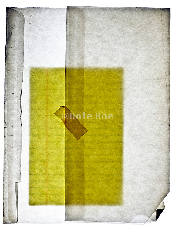 yellow lined notepad paper in translucent envelope