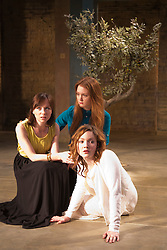"""© Licensed to London News Pictures. 07/04/2014. London, England. L-R: Emily Taaffe as Masha, Olivia Hallinan as Olga and Holliday Grainger as Irina. The play """"Three Sisters"""" by Anton Chekhov, in a new version by Anya Reiss, opens at the Southwark Playhouse, London, with Paul McGann as Vershinin, Olivia Hallinan as Olga, Emily Taaffe as Masha and Holliday Grainger as Irina. Directed by Russel Bolam. Photo credit: Bettina Strenske/LNP"""
