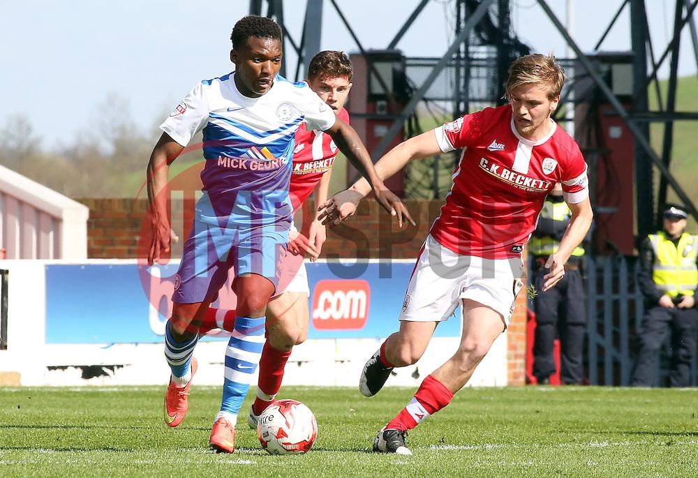 Peterborough United's Kgosi Ntlhe is watched by Barnsley's Luke Berry - Photo mandatory by-line: Joe Dent/JMP - Mobile: 07966 386802 - 18/04/2015 - SPORT - Football - Barnsley - Oakwell - Barnsley v Peterborough United - Sky Bet League One
