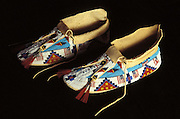 A pair of Sioux mens beaded moccasins with the American US flag and typical tribal designs and patterns