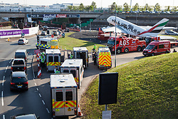 London, UK. 19th April, 2019. Police vehicles, specialist rescue vehicles and large tow trucks at the end of the main motorway approach to Heathrow airport. A large policing operation was put in place in and around the airport in preparation for expected protests by climate change activists from Extinction Rebellion. Only a very small symbolic protest by teenage activists from Extinction Rebellion Youth took place, dispersed by police officers under threat of arrest.