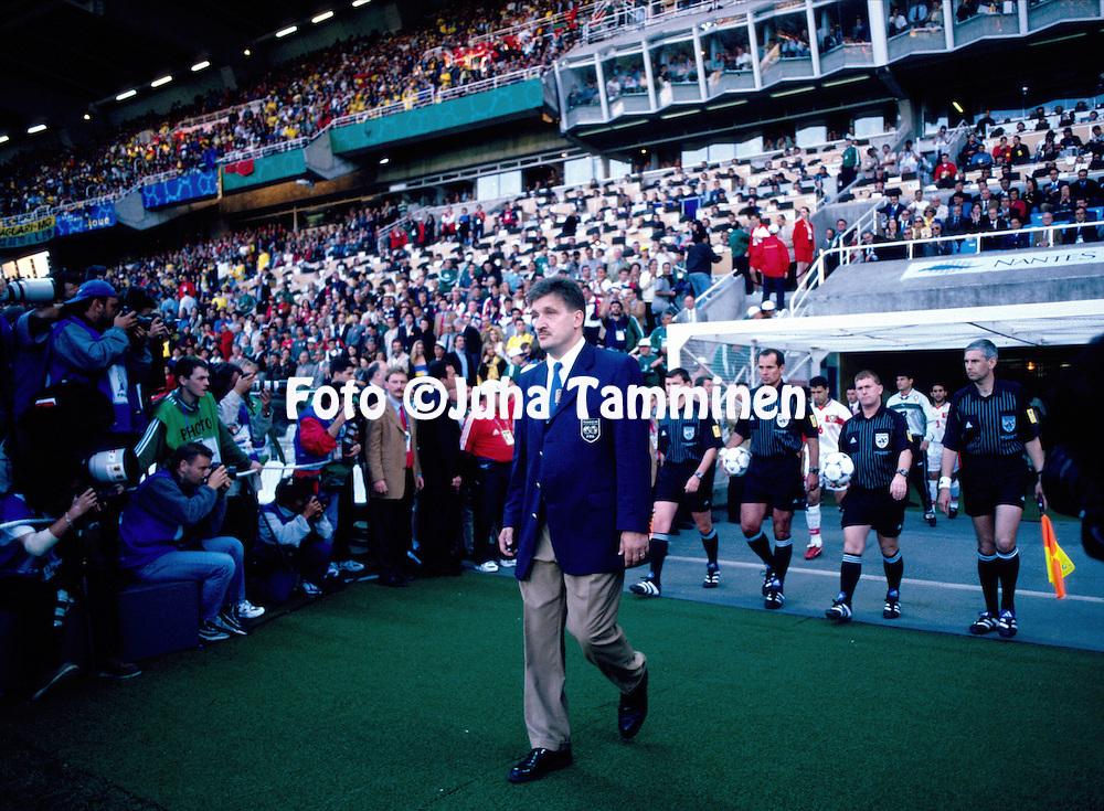 23..06.1998, Stade La Beuajoire, Nantes, France..FIFA World Cup 1998, Brazil v Morocco..Stadium head organizer Pertti Alaja leads the teams out..©JUHA TAMMINEN