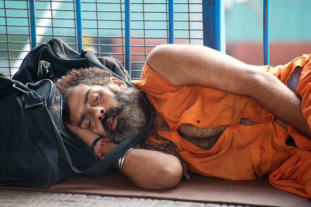 Portrait of Man Sleeping in the street of Delhi, India
