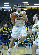 January 14, 2011: Iowa Hawkeyes guard/forward Eric May (25) pulls in a rebound during the NCAA basketball game between the Michigan Wolverines and the Iowa Hawkeyes at Carver-Hawkeye Arena in Iowa City, Iowa on Saturday, January 14, 2011. Iowa defeated Michigan 75-59.