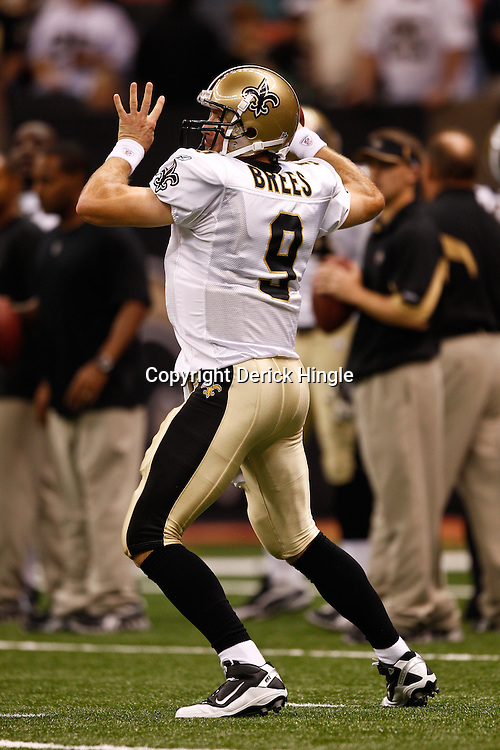 August 27, 2010; New Orleans, LA, USA; New Orleans Saints quarterback Drew Brees (9) prior to the start of a preseason game at the Louisiana Superdome. The New Orleans Saints defeated the San Diego Chargers 36-21. Mandatory Credit: Derick E. Hingle