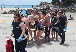 A young man mistimed jumping off the rocks into the sea off Leisure Island, Mt Maunganui suffering a number of injuries and has been taken by ambulance to Tauranga Hospital, New Zealand, Sunday,, December 31, 2017. Credit:SNPA / Richard Moore **NO ARCHINVING**