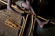 Peelers remove the bark from the stick, the first stage in the preparation of cinnamon quills. Cinnamon quills are made from the bark of the tree so the wooden inside are discarded after the bark is removed. The 'peeling' must be done on the same day as the branch is removed from the tree otherwise the bark won't come off.