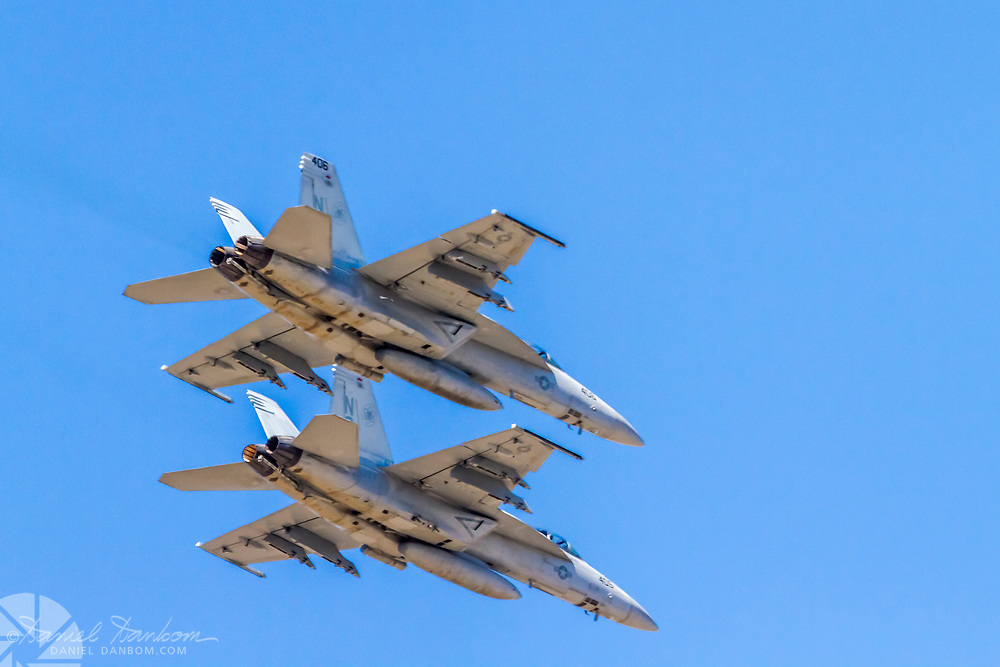 Two F-18s fly over Mazda Laguna Seca Raceway, at the end of the National anthem