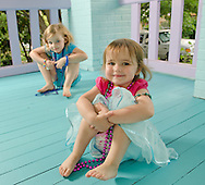 2 kids have fun on the porch.
