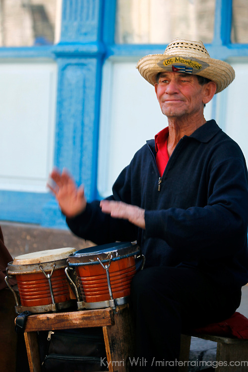 Central America, Cuba, Havana. Cuban Drummer in Old Havana, a band member of Los Mambises.