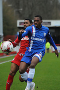 Gavin Tomlin and Amari'i Bell battling for the ball during the Sky Bet League 1 match between Crawley Town and Gillingham at the Checkatrade.com Stadium, Crawley, England on 28 March 2015. Photo by Michael Hulf.