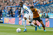 Adama Diakhaby of Huddersfield Town goes past Hull City defender Eric Lichaj (2)  during the EFL Sky Bet Championship match between Huddersfield Town and Hull City at the John Smiths Stadium, Huddersfield, England on 5 October 2019.