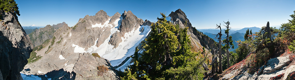 Three Fingers Mountain (6854 feet) and Queest-Alb Glacier are seen from a knoll above Tin Can Gap in Boulder River Wilderness, accessible from Goat Flats Trail #641 starting from Tupso Pass trailhead, Mount Baker Snoqualmie National Forest, near Granite Falls, Washington, USA. Panorama stitched from 16 images.