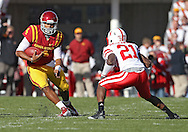 November 06 2010: Iowa State Cyclones quarterback Austen Arnaud (4) tries to avoid Nebraska Cornhuskers cornerback Prince Amukamara (21) during the first half of the NCAA football game between the Nebraska Cornhuskers and the Iowa State Cyclones at Jack Trice Stadium in Ames, Iowa on Saturday November 6, 2010. Nebraska defeated Iowa State 31-30.