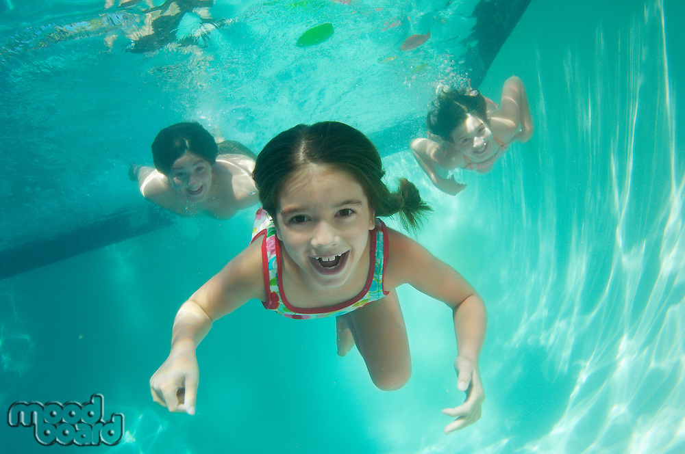 Children swimming, underwater view