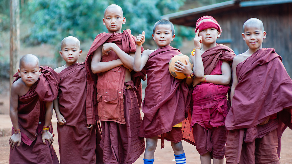Novice Buddhist monks ready to play soccer (Myanmar)