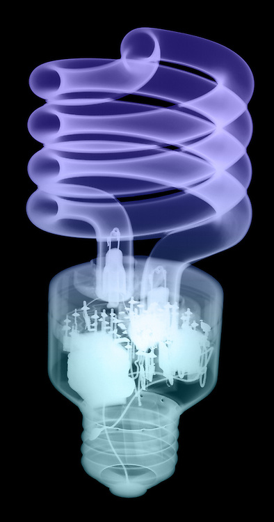 X-ray image of a compact fluorescent bulb (color on black) by Jim Wehtje, specialist in x-ray art and design images.