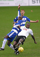 Photo: Jo Caird<br /> Reading v Derby<br /> Madejski Stadium<br /> Nationwide Div 1 2004<br /> 31/01/2004.<br /> <br /> MIcheal Johnson lunges for the ball v Dean Morgan