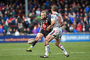 Blake Austin (6) of Warrington Wolves kicks the ball forward during the Betfred Super League match between Wakefield Trinity Wildcats and Warrington Wolves at Belle Vue, Wakefield, United Kingdom on 16 February 2020.